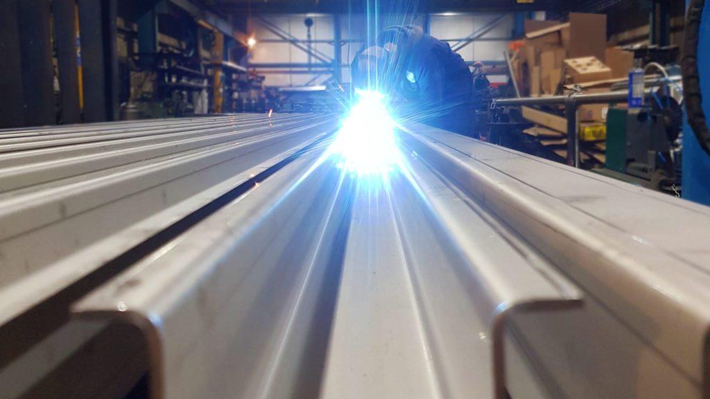 Man welds at White Cross Ring Fabricators